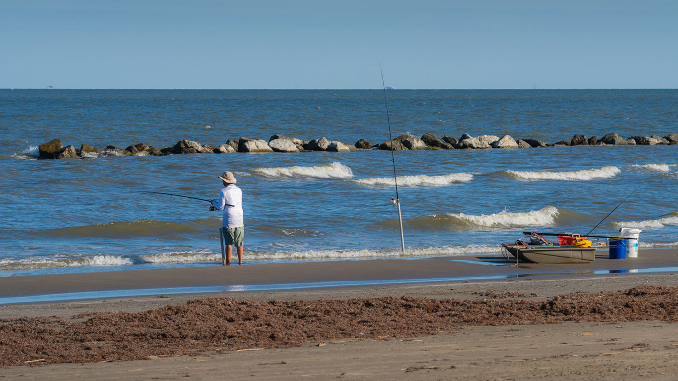 Man fishing on the beach at Grand Isle State Park