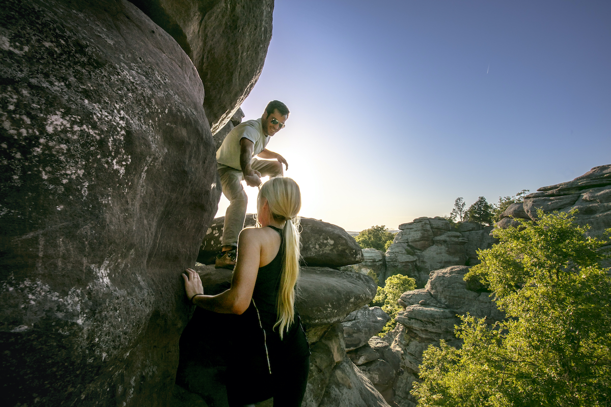 Couple Climbing Up at Garden of the Gods