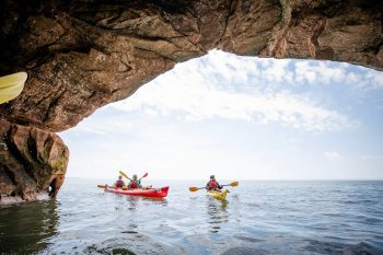 Kayakers in Sea Caves at Apostle Islands in Bayfield