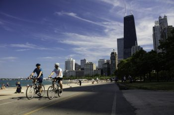 couple bicycling on lakefront in chicago