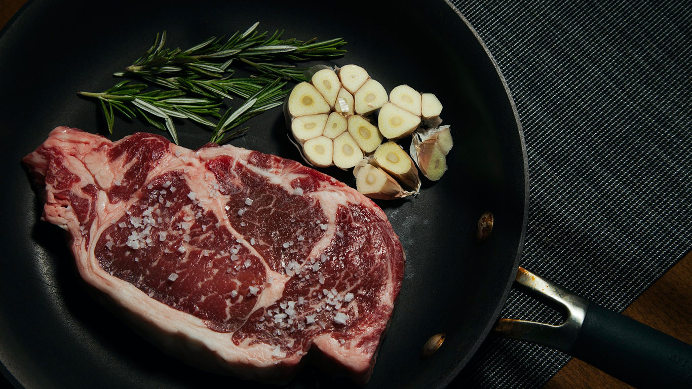 Steak thyme and garlic on a pan